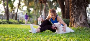 A woman and her dog exercise together.